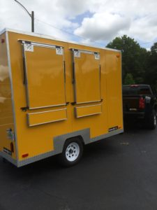 "7'9"" x 12' Yellow Trailer with Side windows."