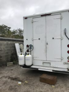 Truck with dual propane tanks.